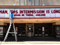 Grayson Allred places the final letter in a new message to the community on the Paramount Theatre's marquee Thursday April 16, 2020. Executive Director George Levesque said they change the message weekly.