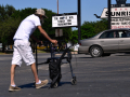 A man pushes a walker to the drive-up window at The Oasis Spirits & Wine on South First Street Thursday as temperatures reached into the upper 80s April 30, 2020.