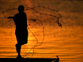 Daniel Chavez, 14, throws a net into the water from a Kirby Lake dock Saturday May 9, 2020. Fishing with father Rito Chavez Jr., the pair was having mixed luck as the sun set.