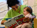 Olivia Rivera reads a book to four-month-old Isabella Gonzales at the Vine Street Day Nursery of Abilene Friday July 17, 2020. After 40 years, Rivera is retiring.
