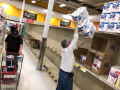 A customer reaches for multipacks of toilet paper at an Abilene store Thursday March 12, 2020. Shoppers at stores across the city were cleaning out shelves of toilet paper in response to Coronavirus fears.