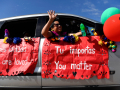 Josie Rektenwald waves to the residents of Willow Springs Health and Rehabilitation Center during a Cinco de Mayo parade for nursing homes Tuesday May 5, 2020. About 20 vehicles decorated with festive colors and uplifting signs drove past seven nursing homes.
