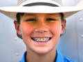 Dylan Muehlstein, 12, sports patriotic braces Thursday at the Texas Cowboy Reunion July 2, 2020. This is the 90th year for Stamford's rodeo which concludes Saturday night.