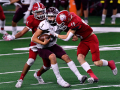 Jim Ned linebackers Sergio Hernandez (left) and Kaeden Sands sack Hallettsville quarterback Trace Patek during the Class 3A Division I state  championship Thursday at AT&T Stadium Dec. 17, 2020. Final score in overtime was 29-28, Jim Ned.