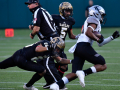 Abilene High defensive backs Joseph Woodyard (5) Isaiah Salinas run past a game official as they chase Denton Guyer defensive back Brailynn Pegues during Saturday's Region I-6A D-II semifinal football game at Globe Life Park in Arlington Dec. 26, 2020. Final score was 38-21, Denton Guyer.