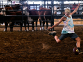 Gage Talley, 15 of Archer City, hones his kickoff skills before a bovine audience Thursday at the Taylor County Expo Center Sept. 3, 2020. Gage is showing Hereford cattle with his family.