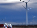 Wind turbines rise to the south of Hermleigh High's Spieker Stadium as the ACHS Panthers huddle Saturday Dec. 5, 2020. They played the Lubbock Kingdom Prep Warriors in the Division III Six-Man state quarterfinal game.