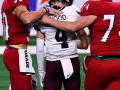 Jim Ned players Don Bridges (50) and Noah Powell (74) comfort Hallettsville's Deven Wood after the Class 3A Division I state championship Thursday at AT&T Stadium Dec. 17, 2020. Final score in overtime was 29-28, Jim Ned.