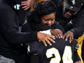 Abilene High quarterback Jeshari Houston is comforted by family members after the Eagles' loss to Denton Guyer Saturday at Globe Life Park Dec. 26, 2020. Final score was 38-21, Denton Guyer.