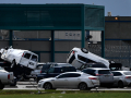 A van and an SUV are stacked atop other vehicles in the parking lot of the French Robertson Unit outside of Abilene Thursday March 19, 2020. Tornadoes from an early morning thunderstorm wreaked havoc from Tye to the prison, destroying buildings and killing livestock.