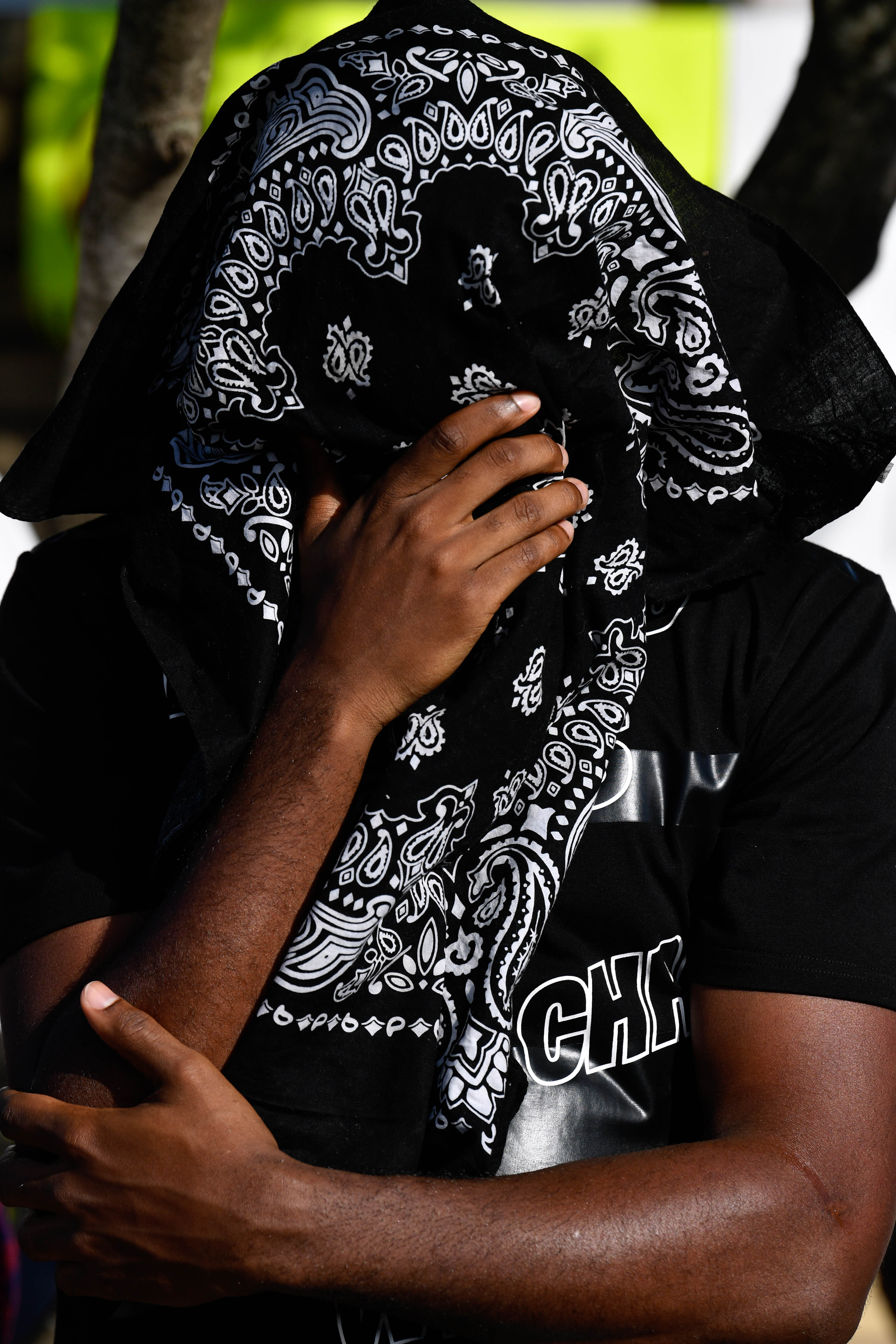 Mekenzie Davis covers his face as he prays during a rally against racism and national acts of police brutality Thursday June 4, 2020. It was held beside the Martin Luther King Jr. sign on E. Highway 80.