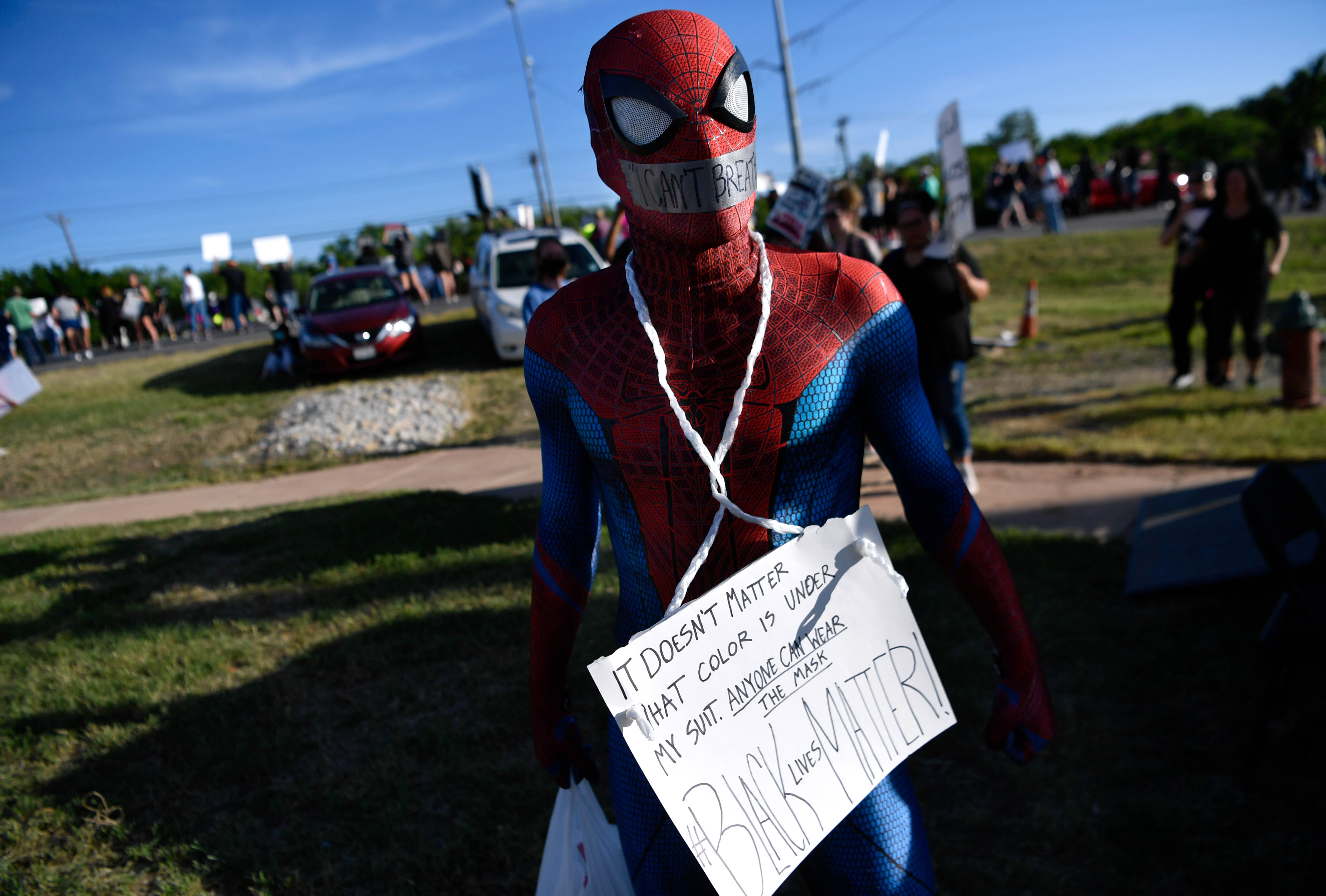 Chris Craig wore a Spider Man costume and a sign to show support for Black Lives Matter at Thursday's rally near the Martin Luther King Jr. sign on E. Highway 80 June 4, 2020.