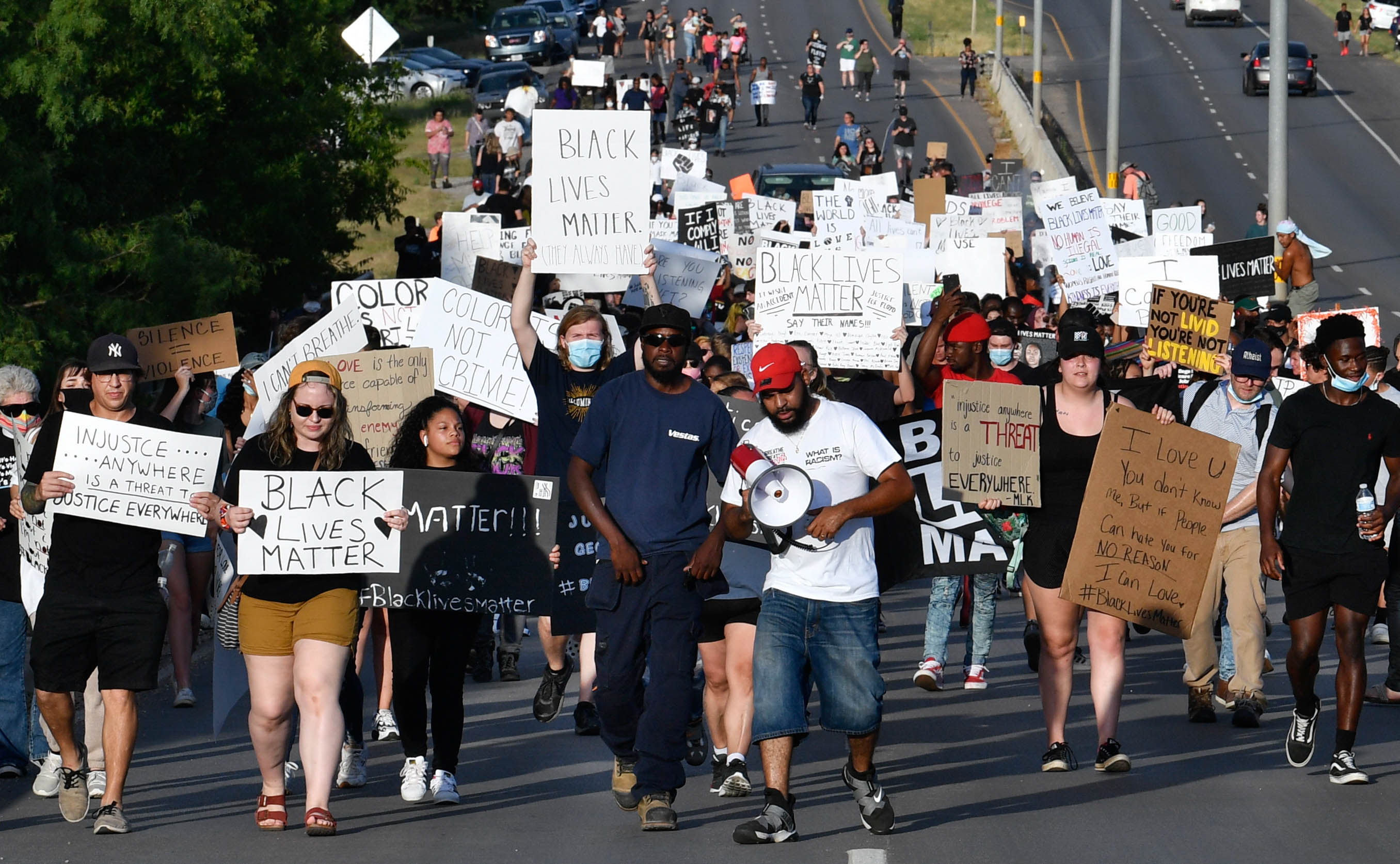 Demonstrators march over the Martin Luther King Jr. bridge on their way into downtown Abilene Thursday June 4, 2020. The group, protesting nationwide police brutality, peacefully marched to Grape St. before returning.