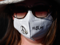 Molly Favor wears her customized mask as she listens to speakers during a rally in Abilene Thursday to remember national victims of police brutality June 4, 2020.