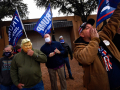 Toby Lindley adjusts his rubber Donald Trump mask as he joined other Republican supporters heckling Democrats at Abilene's Vera Minter Park where the Biden-Harris campaign bus had stopped Wednesday Oct. 28, 2020. Local Democratic candidates spoke to the crowd for about half an hour before the bus left.