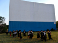 Eula seniors walk away from the Town & Country Drive-In's 100-foot screen after taking a group picture May 22, 2020. Eula ISD rented the Abilene drive-in for their commencement.