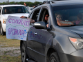 A passenger holds a sign for a graduating Eula High senior out a back window at Abilene's Town & Country Drive-In Theatre May 22, 2020.