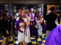 Seniors call parents to let them know the plan for the Wylie High School graduation as the severe thunderstorm that interrupted it continues to blow outside Friday June 19, 2020. Some seniors opted to continue with the ceremony inside the Doghouse athletic building that evening, while others waited for the continued ceremony the next morning back on the football field.