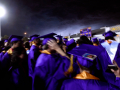 With lightning flashing in the overhead sky, seniors rush off the football field at Wylie High School Friday as a severe thunderstorm interrupts commencement June 19, 2020.